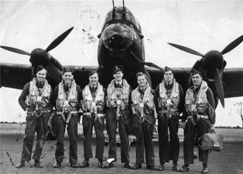 The crew of British Avro Lancaster bomber in front of his plane